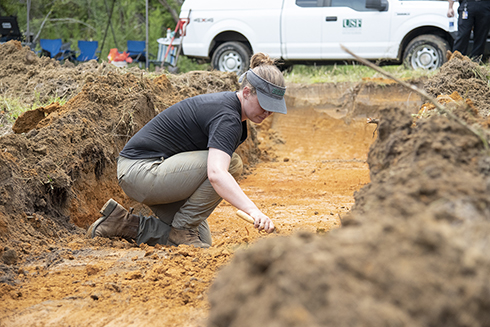 A USF researcher excavating land near the former Dozier School for Boys