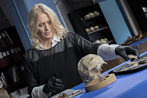USF researcher, Erin Kimmerle, PhD, examines bone fragments potentially belonging to Amelia Earhart