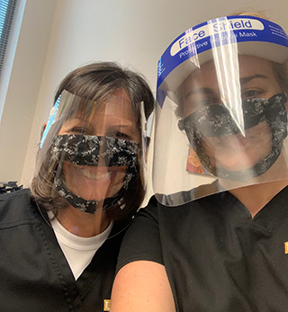 USF audiologists wearing the face masks designed for hearing impaired individuals