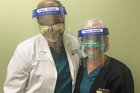USF audiologists wearing facemasks designed for the hearing impaired