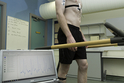 A man wearing the noninvasive device being developed to detect the progression of COVID-19