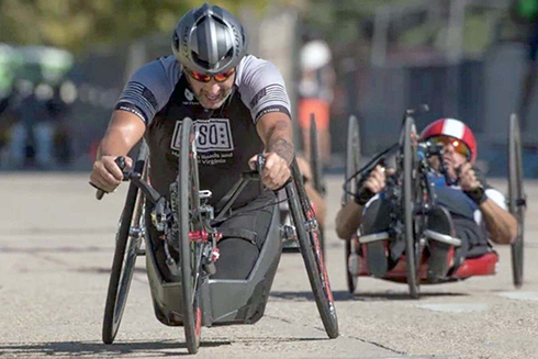 U.S. Army veteran Omar Duran competing in a hand-cycling competition