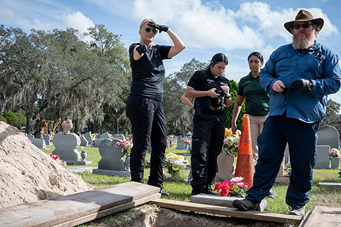 Erin Kimmerle, associate professor of forensic anthropology, assists a body exhumation at the Rest Haven Cemetery in Tampa.