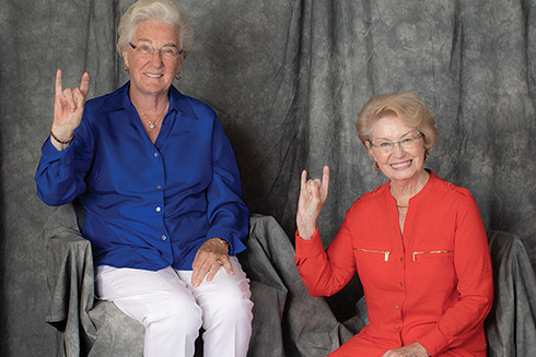 Kate Tiedemann and Ellen Cotton holding up the Go Bulls hand sign