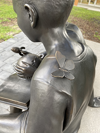 A sculpture featuring two African American children at a Tampa library