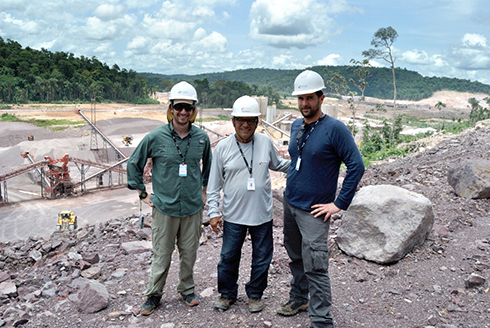 Arias (left) and European Commission Joint Research Centre collaborator Fabio Farinosi (right) stand with the chief construction engineer of one of the Amazon dams investigated in Arias' and Farinosi's recent paper.