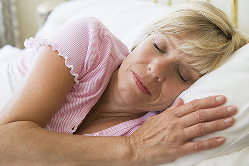 A stock photo of a woman sleeping