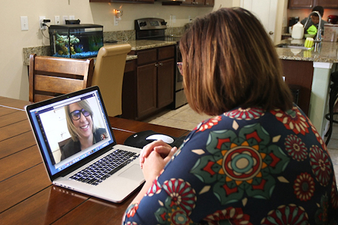 At home, a USF Health patient connects with Jen Farrant, administrator with USF Health Family Medicine.