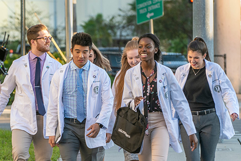 A group of medical students walking to campus