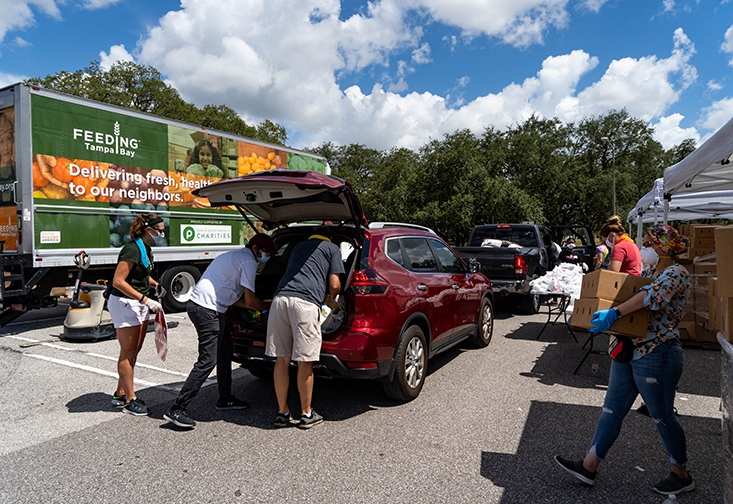 USF volunteers loading food into cars during Feeding Tampa Bay's Mega-Pantry event at USF
