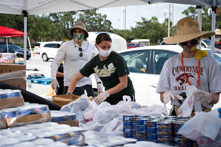 USF volunteers sorting food to be donated