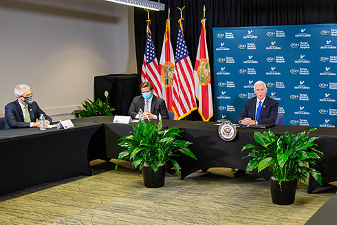 Vice President Mike Pence, Florida Governor Ron Desantis and USF President Steve Currall discussing COVID-19 at a roundtable session
