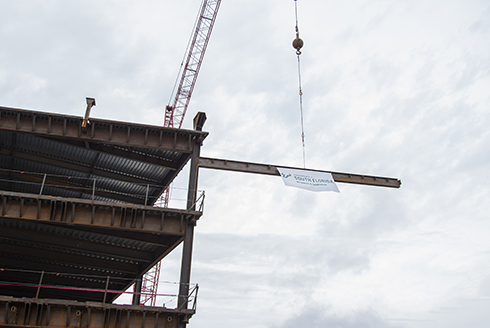 Construction crews gave the USF Research Park a new milestone to celebrate as they hoisted to the last beam that will sit on the highest point of the new 120,000-square-foot building.