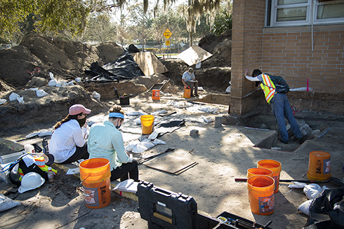 Archaeologists from USF/FPAN and Cardno work on excavating grave shafts at the North Greenwood cemetery