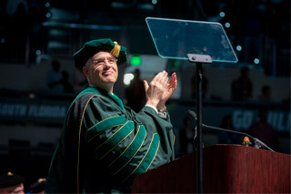 President Steven Currall in academic regalia at commencement