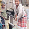 Young Malagasy girl obtaining water from locally manufactured hand