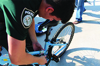 Policeman fixing a bike