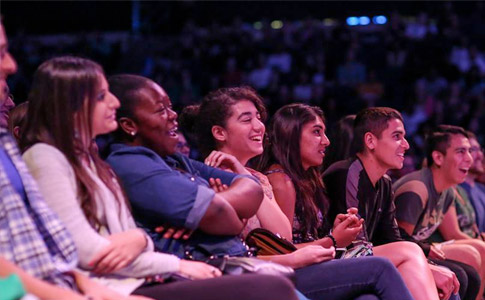 Students laughing in the audience at the 2014 Student Talent Showcase