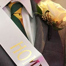 Closeup of a boutonniere on a homecoming candidate's suit