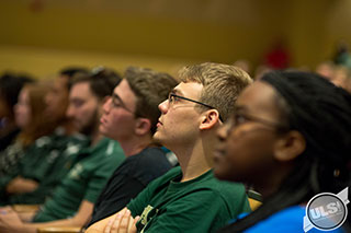 USF students listening at a lecture