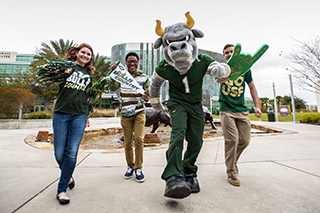 Rocky the bull and students walking with each other