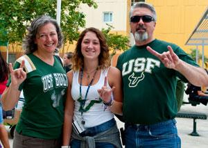 /student-affairs/student-health-services/about-us/incomingstudents.aspx New USF student with parents wearing USF appearel