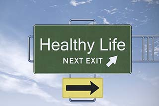 road sign pointing to Healthy Life photo
