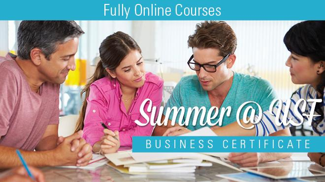 Picture of adults looking at papers with Fully Online Courses, Summer @ USF Business Certificate