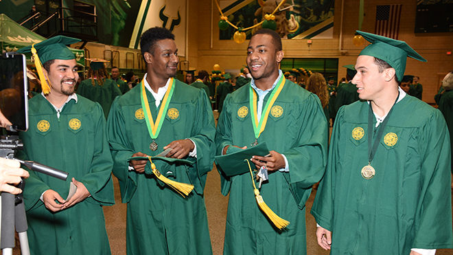 Candid of group of USF graduates at Commencement