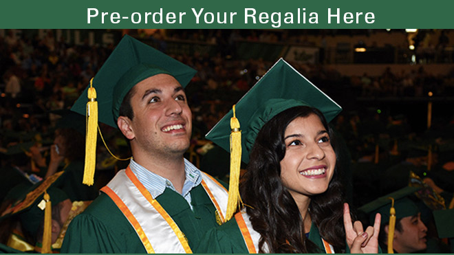 USF grads at commencement smiling and showing the Bulls sign click here to order your regalia