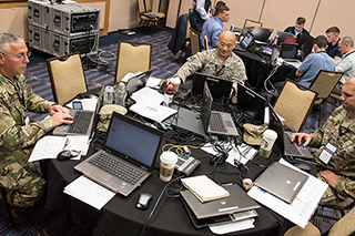 Military members during a challenge at the cyber conference