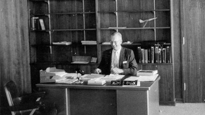 John S. Allen at his desk