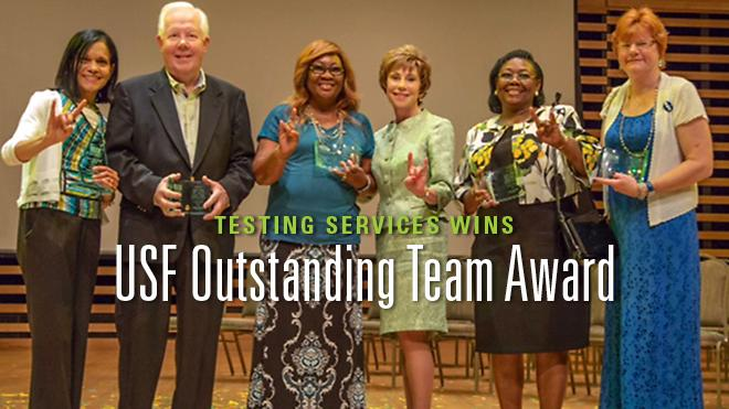 A group of woman and a man at the USF Outstanding Team Award with President Genshaft.