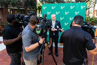 President Steven Currall answering media questions on his first day at USF.