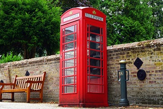 How to Call When Abroad. The picture shows a red phone booth in England