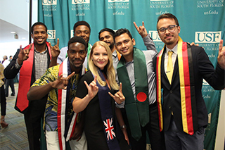Shahryar (second from the right), poses with other international graduates, after the USF International Sash Ceremony, a ceremony that recognizes graduates from the international community.