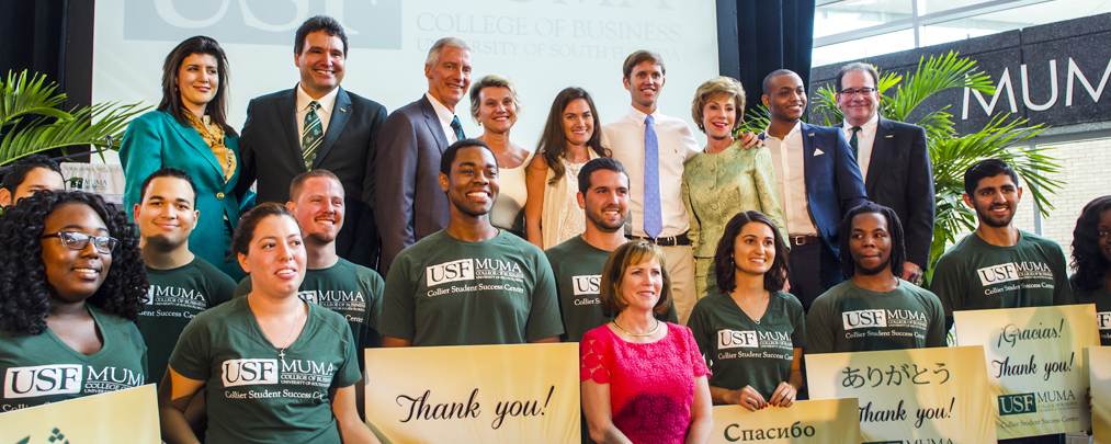 Colliers with USF students at Muma gift announcement