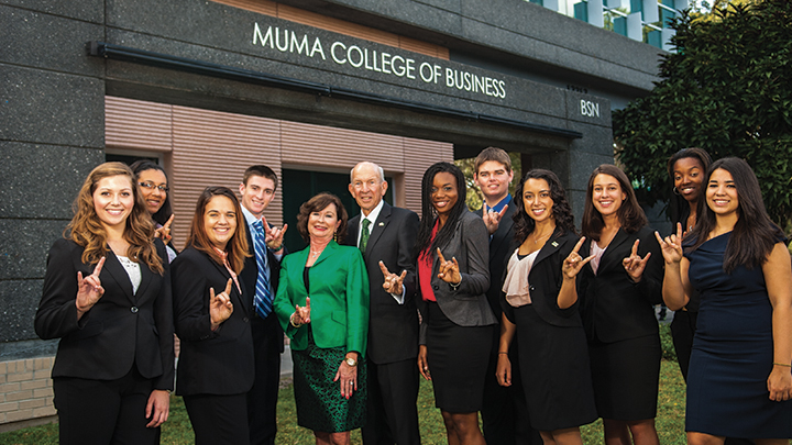 Pam and Less Muma with a group of USF business students