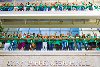 USF students standing on the balcony of Lynn Pippenger Hall