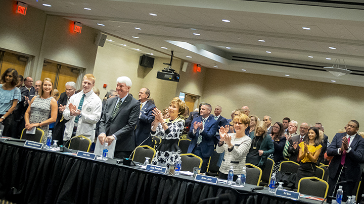 Judy Genshaft, Provost Ralph Wilcox and a crowd of enthusiastic Bulls react to the Board of Governors' vote
