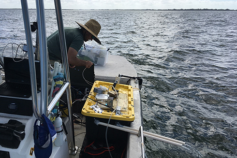 Chris Moore making adjustments to the automated, flow-through pH sampler out at the mouth of Tampa Bay.