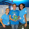 Drs Erin Symonds, Mya Breitbart and Karyna Rosario at their 'World of Microbes' station as part of the St. Petersburg Science Festival.
