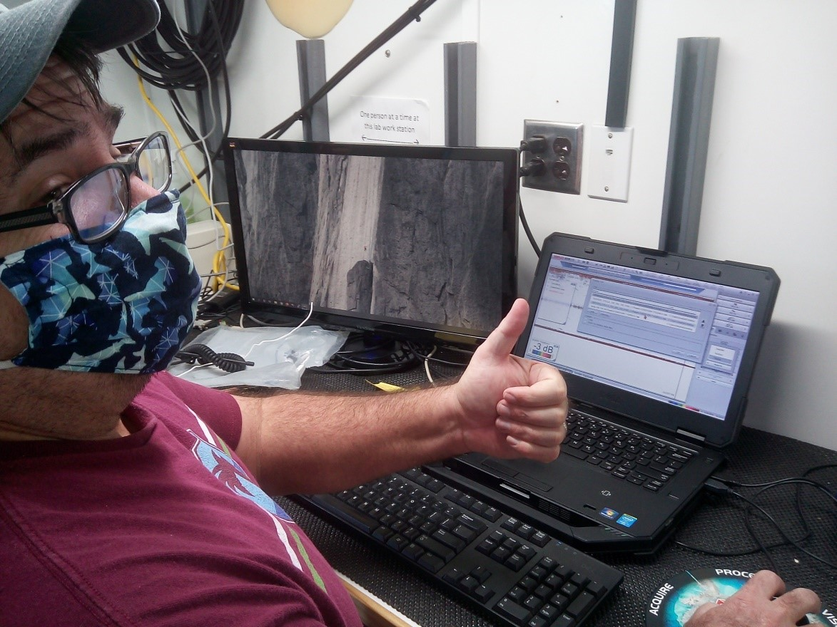 Eddie Hughes gives the thumbs up to the camera, indicating desired calibration readings.
