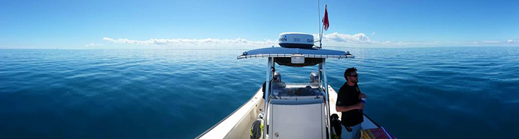 Joshua Kilborn, PhD, on watch offshore Tampa Bay while divers conduct fish surveys for the Fish Ecology Lab.