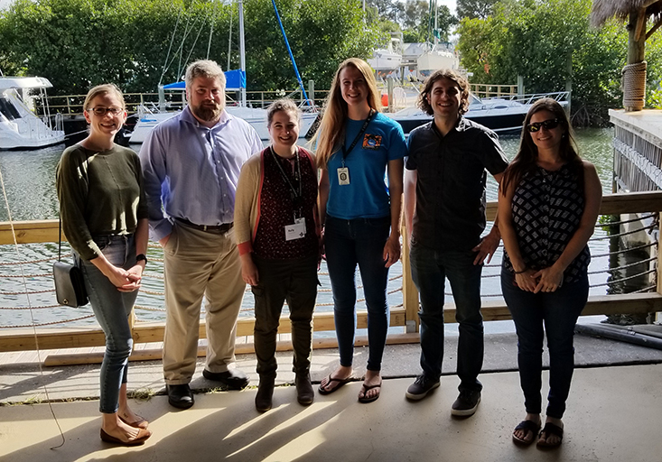 Past and current members of the lab managed by Cameron Ainsworth, PhD, one of the faculty who manage the Marine Resources Assessment (MRA) program. Michelle Masi is on the far right.